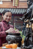 Woman offering incense, temple, Beijing Stock Images