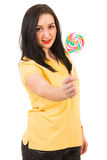 Woman offering lollipop Stock Images