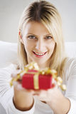 Woman offering present Stock Image