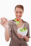 Woman offering salad on a fork Royalty Free Stock Image