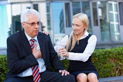 Woman offering senior business man Royalty Free Stock Photography