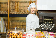 Free Woman Offering Tasty Pastry Stock Image - 71198441