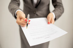 Woman offering to sign papers royalty free stock photography