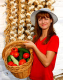 Woman offering vegetables Stock Photography