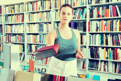 Woman offers a book in a bookstore Stock Photos