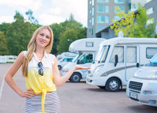 Woman offers campervans. Royalty Free Stock Image
