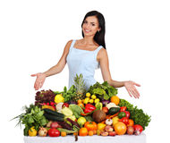 Woman offers fruits and vegetables Royalty Free Stock Photo