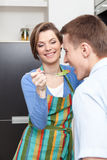 Woman offers her husband to taste salad Stock Image