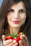 Woman offers strawberries on her hands Royalty Free Stock Photography