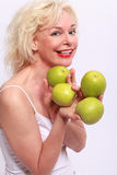 Woman offers to apples Royalty Free Stock Image