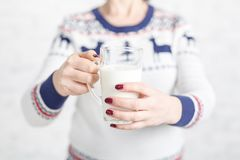 Woman offers to drink a mug of milk Stock Photo