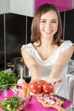 Woman offers tomatoes Royalty Free Stock Photos