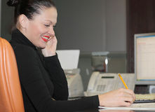 Woman in office. A portrait of a young business woman in an office Royalty Free Stock Image
