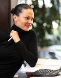 Woman in office. A portrait of a young business woman in an office Royalty Free Stock Photography