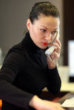 Woman in office. A portrait of a young business woman in an office Royalty Free Stock Images