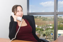 Woman in the office Stock Images