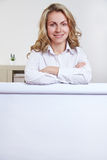 Woman in office behind flipchart Stock Photography