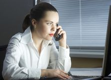Woman at office calls on the phone Royalty Free Stock Photo