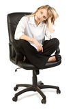 Woman in office chair Stock Images