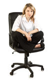 Woman in office chair Royalty Free Stock Images