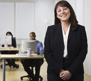 Woman in Office with Co-workers Stock Photo