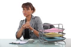 Woman in office with coffee. Woman sitting in office with coffee cup stock photography