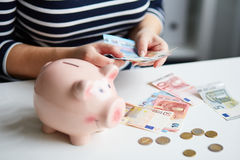 Woman in the office counting money Royalty Free Stock Image