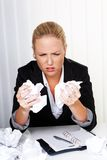 Woman in office with crumpled paper Royalty Free Stock Photos