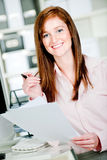 Woman at Office Desk Royalty Free Stock Images