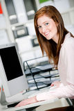 Woman at Office Desk Stock Photo