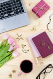 Woman office desk with notebooks, laptop, decor and accessories, top view, copy space. Woman office desk with notebooks, laptop, decor and accessories royalty free stock image