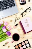Woman office desk with notebooks, laptop, decor and accessories, top view, copy space. Feminine desktop flat lay royalty free stock image