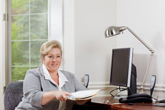 Woman office desk paperwork Stock Image