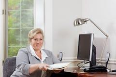 Woman office desk paperwork Stock Image