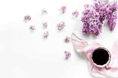 Woman office desk with scarf, coffee and lilac blossom design white background top view mockup stock image