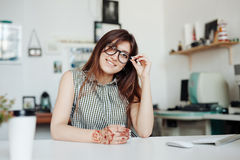 Woman in office having a break for rest. Royalty Free Stock Photo