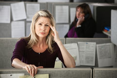 Woman in Office with Headache Royalty Free Stock Image
