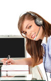 Woman in office with headset Royalty Free Stock Photos