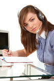 Woman in office with headset Royalty Free Stock Photography