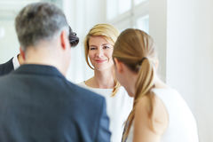 Woman in office with her colleagues Royalty Free Stock Photo