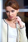 Woman  in a office interior Stock Photography