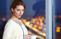 Woman  in a office interior Royalty Free Stock Photos