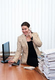 Woman in office interior calling by telephone Royalty Free Stock Photo
