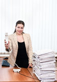 Woman in office interior holding telephone Royalty Free Stock Photo