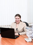 Woman in office interior holding telephone Royalty Free Stock Photography
