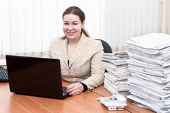 Woman in office interior holding telephone Stock Image