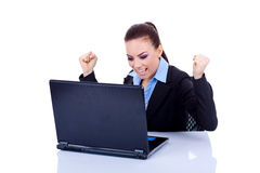 Woman in office jubilates at desk Royalty Free Stock Image