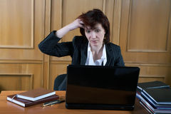 The woman at office keeps  for a head Royalty Free Stock Photo