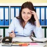 Woman at office laughing at camera Stock Image