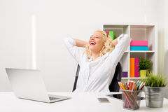 Woman at the office leaned back in her chair Stock Images